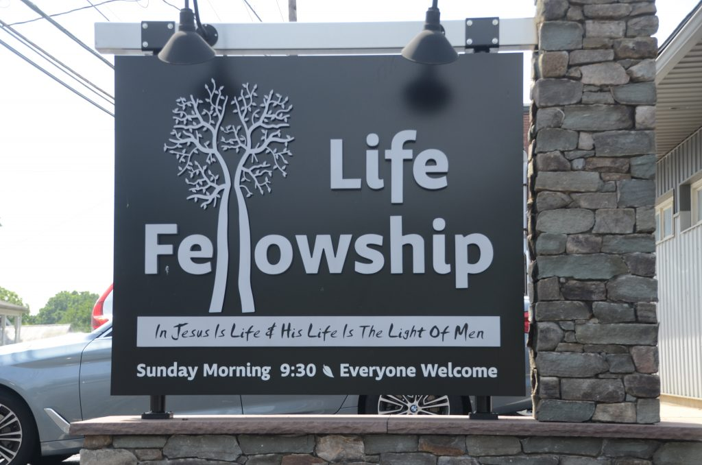 The Life Fellowship sign out in front of the Church.